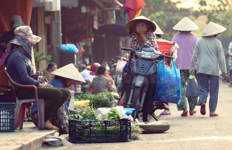 Vendor selling greens in market in Hoi An stock photography