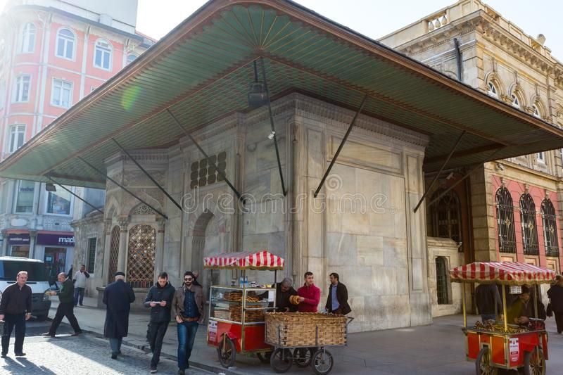 A Vendor Sells Food on a Street Corner. A street vendor sells warm food items in Istanbul, Turkey on a cold winter morning in the sun stock photography