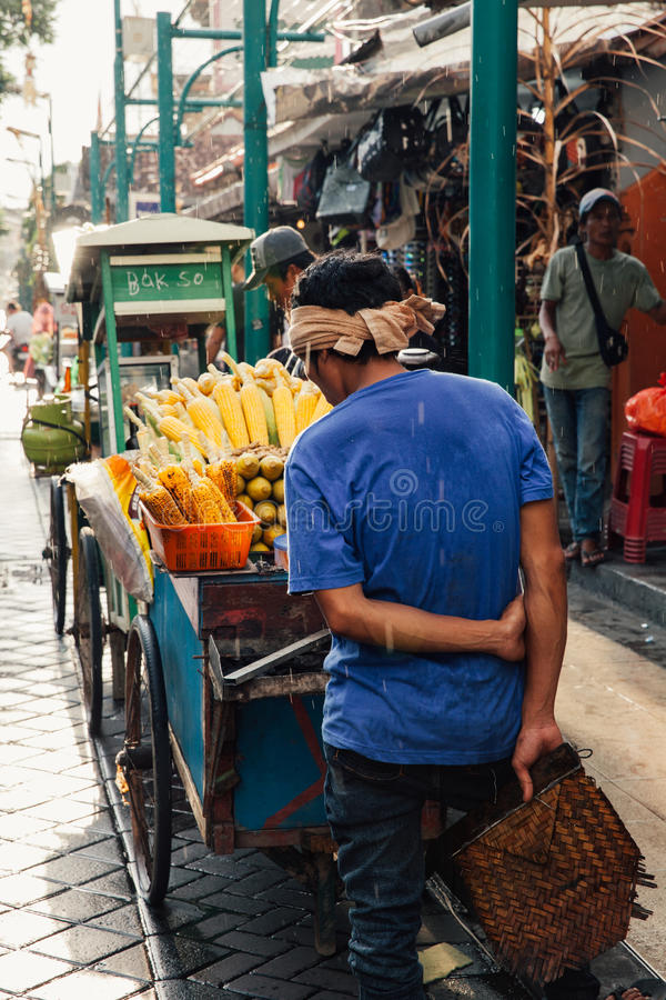 Download Vendor Sells Grilled Corn, Ubud, Bali Editorial Photography - Image of local, light: 74119647