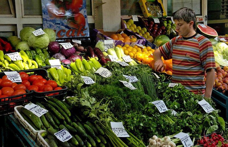 Vendor sells vegetables at the market. In Sofia, Bulgaria Jun 16, 2008 royalty free stock images
