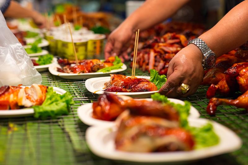 Vendor Serving Meat In Plates At Thai Street Food stock image