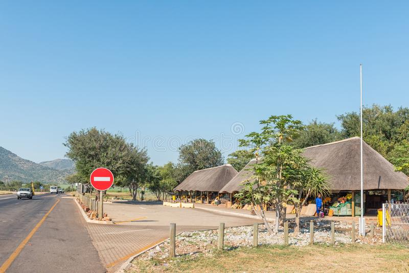 Vendor stalls on road N4 near Malalane. KAAPMUIDEN, SOUTH AFRICA - MAY 3, 2019: Vendor stalls on road N4 near Malalane in the Mpumalanga Province. Vehicles and royalty free stock photo