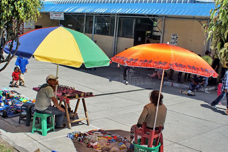 Vendors at the market. Vendors under colorful umbrellas at the market in Cotacachi, Ecuador royalty free stock image