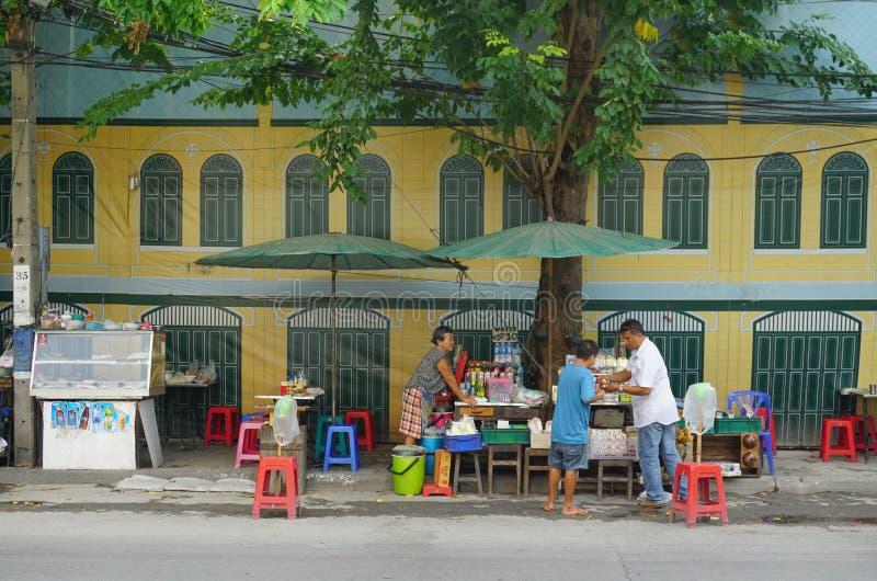 Vendors prepare traditional street food stock photos