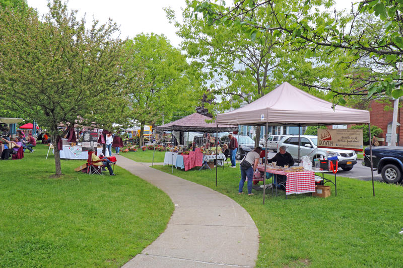 Vendors and shoppers at the farmers market in Hamilton, New York. Vendors and shoppers at the local, Saturday farmers market in the village of Hamilton near stock photos