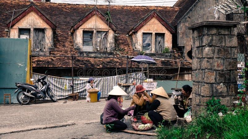 Vendors sitting on street in Dalat, Vietnam stock photo