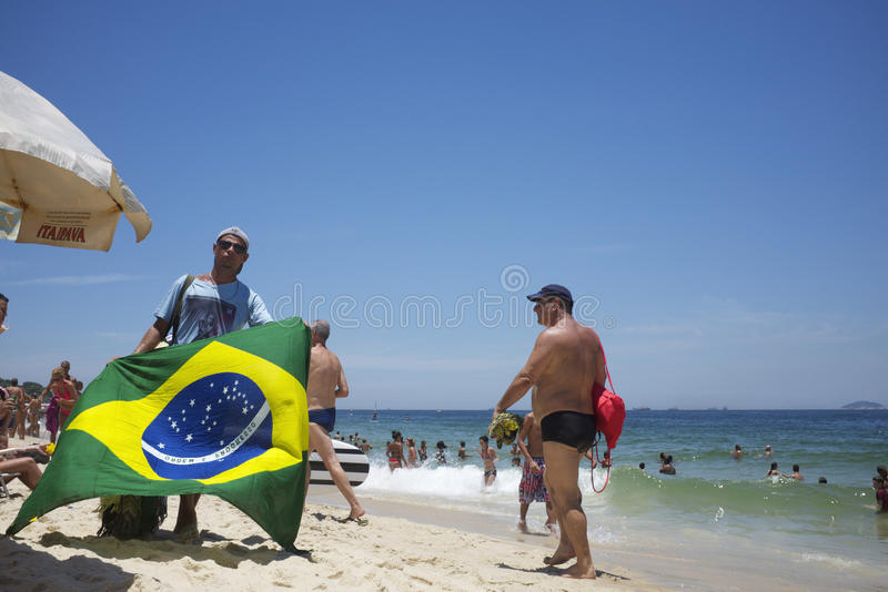 Vendors And Sunbathers On Ipanema Beach Rio Editorial Stock Image