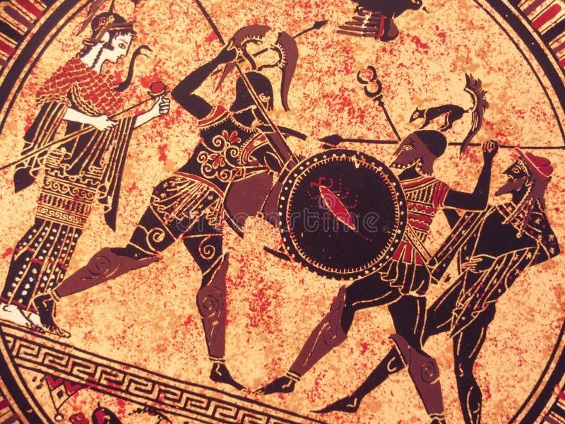 VENECIA, ITALIA - 2 DE JULIO DE 2017: Detalle de una pintura griega histórica vieja sobre un plato Héroes míticos y dioses que lu imagen de archivo libre de regalías
