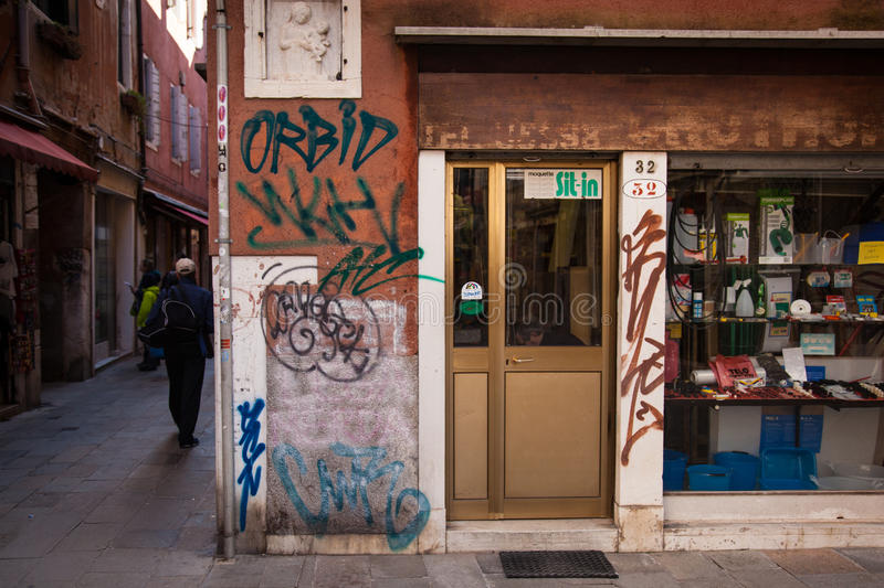 Venetian backstreet shop with Grafitti stock photo