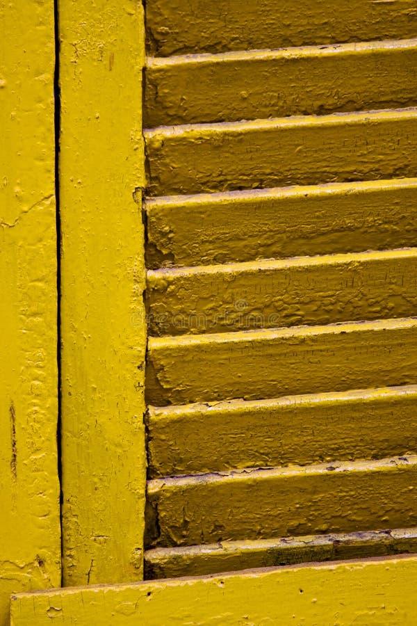 Venetian blind in buenos aires la boca. Yellow venetian blind in buenos aires la boca stock photos