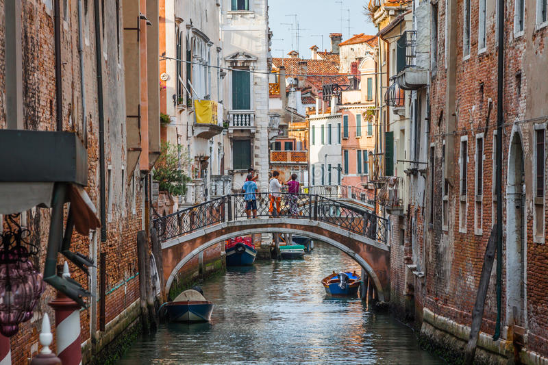 Venetian buildings and boats along Canal Grande, Venice, italy royalty free stock image