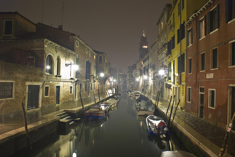 Venetian canal at night. stock image