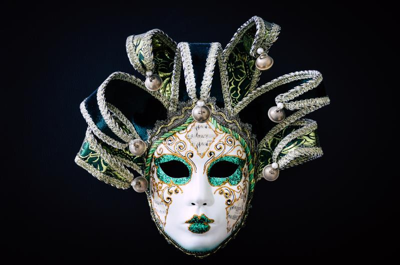 Venetian carnival mask isolated on black background. Traditional carnival in Venice. Green and white mask with glitters. royalty free stock photography