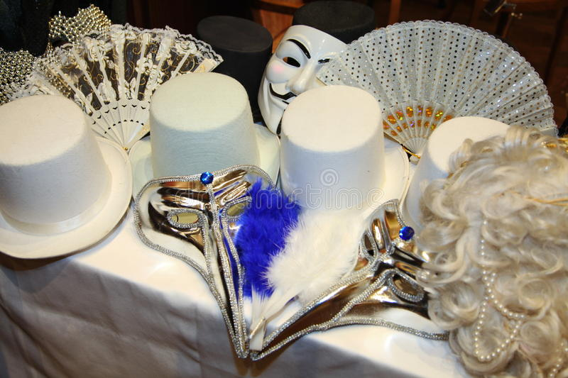 Venetian carnival masks. Party masks on a table. stock photo