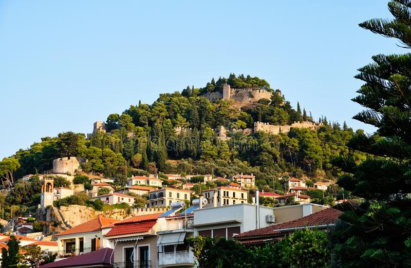 Venetian castle Above Nafpaktos City, Greece. Early morning iew of the Venetian castle on a tree covered hill overlooking Nafpaktos city or town, Gulf of Corinth royalty free stock photo