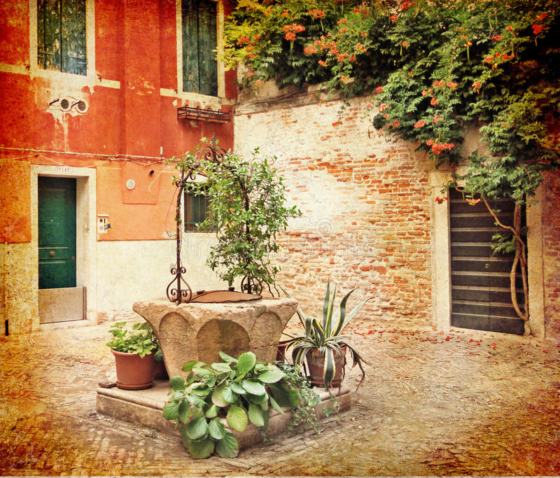 Venetian corner with water well royalty free stock image