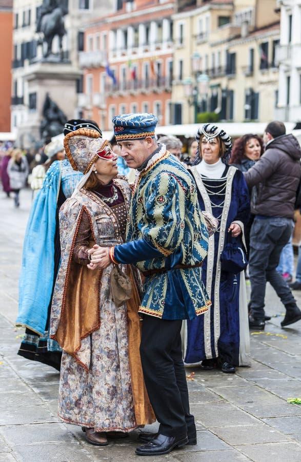 Venetian Couple Dancing - Venice Carnival 2014 royalty free stock photos