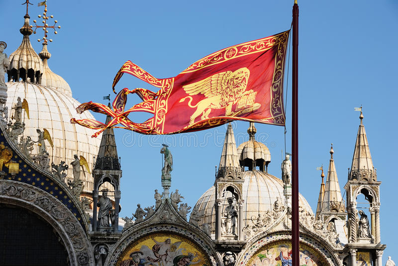 The Venetian Emblem. Lion. Against Basilica of San Marco stock photo