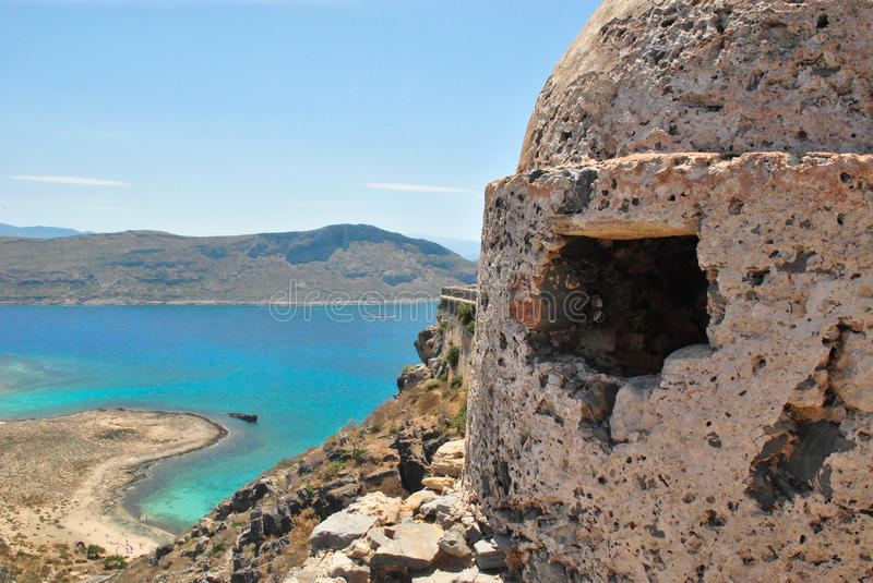 Venetian fort of Gramvousa. View from above to beach from Venetian fort of Gramvousa near fire position tower royalty free stock photos