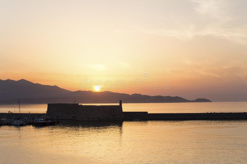 Venetian fortress Koules in Heraklion. In Crete with the rising sun royalty free stock photo