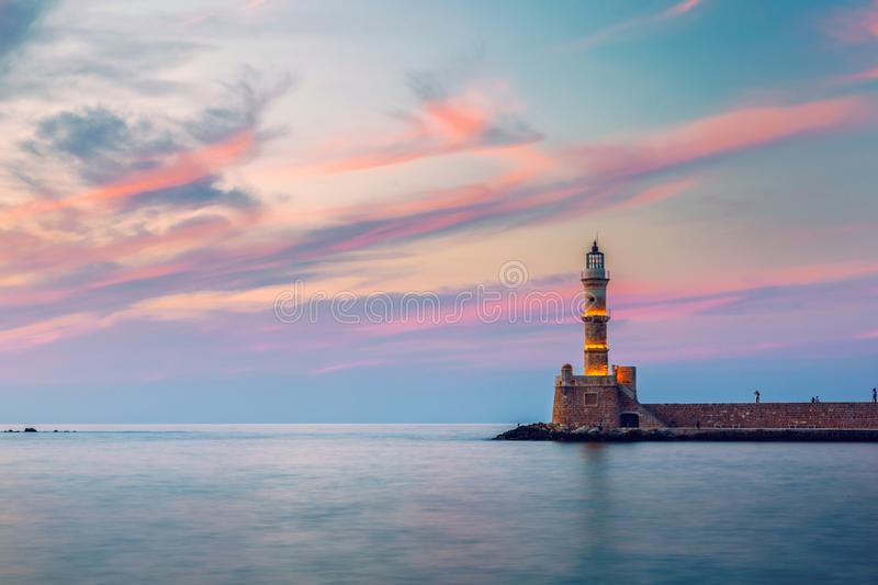 Venetian harbour and lighthouse in old harbour of Chania at sunset, Crete, Greece. Old venetian lighthouse in Chania, Greece. Lighthouse of the old Venetian royalty free stock photography