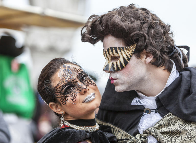 Venetian Kiss - Venice Carnival 2014 royalty free stock images