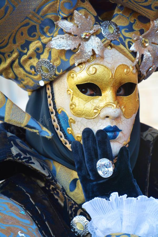Venetian mask in blue hues, in Venice, Italy, Europe. Romantic Venetian mask with golden decorations and arabesques, in blue hues, in St Mark`s Square, during royalty free stock images