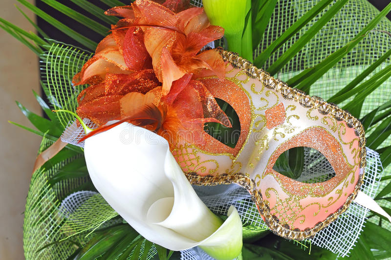 Download Venetian mask and flowers stock photo. Image of identity - 19041644