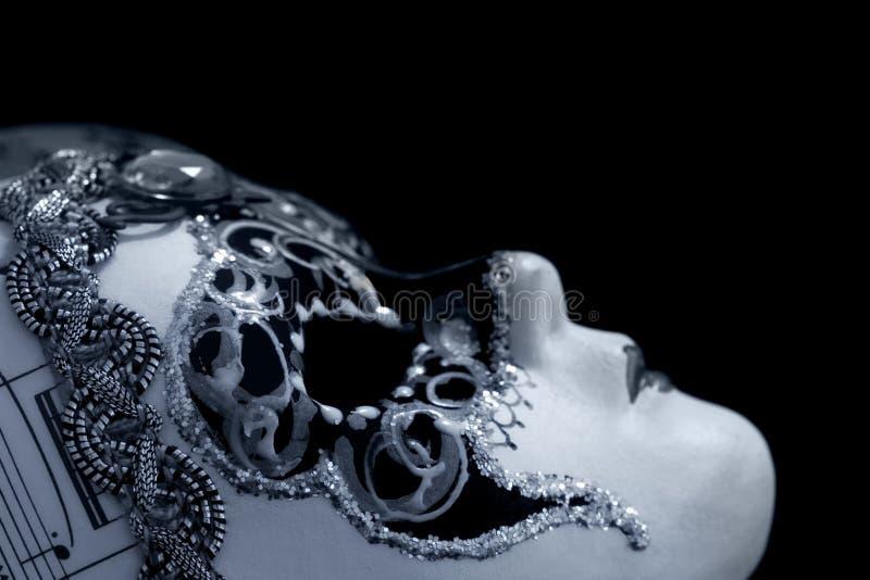 Venetian maskera över svart royaltyfri foto