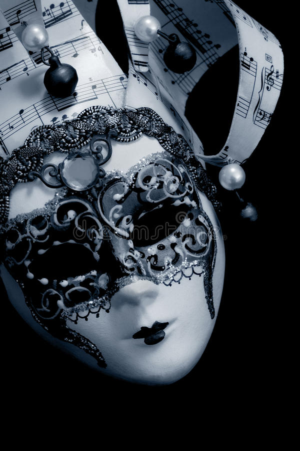 Venetian maskera över svart royaltyfria foton