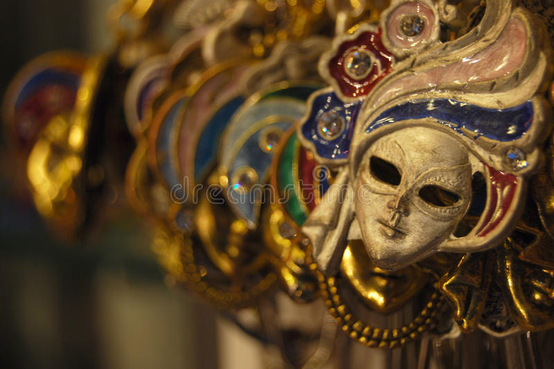 Venetian Masks Artwork. Display of Venetian Masks in a Shop Window royalty free stock photo