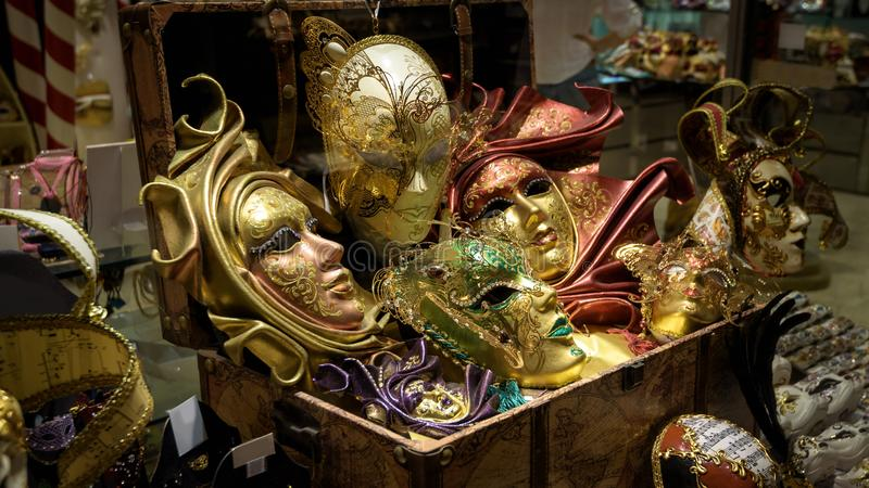 Venetian masks in store window, Venice, Italy. Famous carnival in Venice is an annual costume festival, which attracts many. Tourists. Beautiful gold masks for stock photos