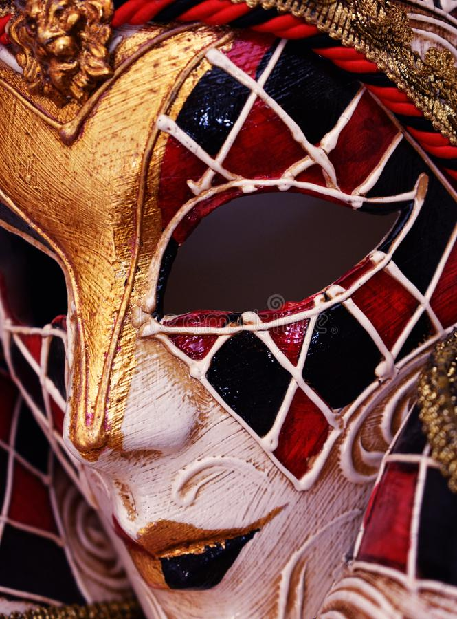 Venetian Masquerade Mask Harlequin Design in Papier Mache. A stunning authentic papier macher masquerade mask from Venice Italy with traditional harlequin red royalty free stock photos