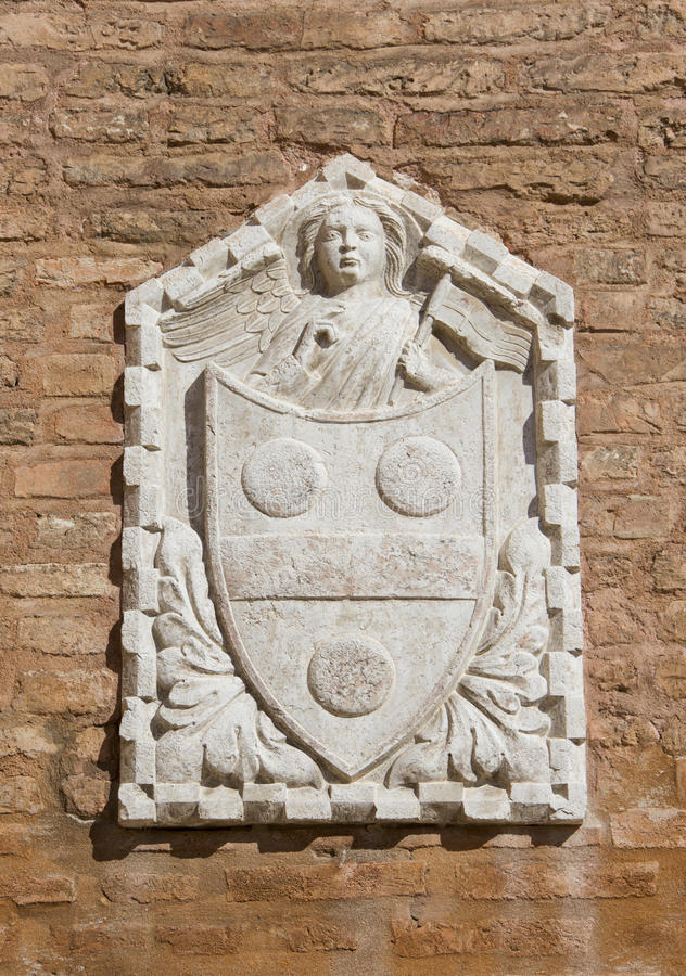 Venetian relief with coat of arms with angel royalty free stock photo