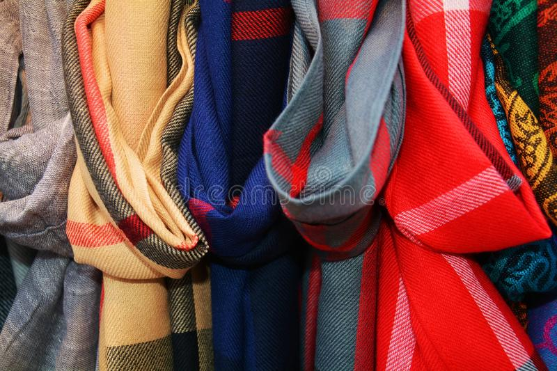 Venetian scarves background and texture. Venetian textile scarves background in blue, red, grey and beige hues royalty free stock photos