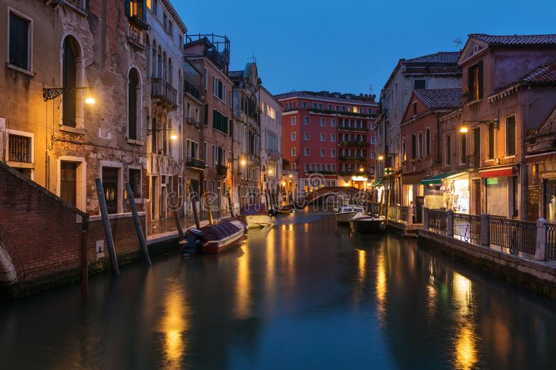 Venetian water сanal at night in Venice. Italy stock images