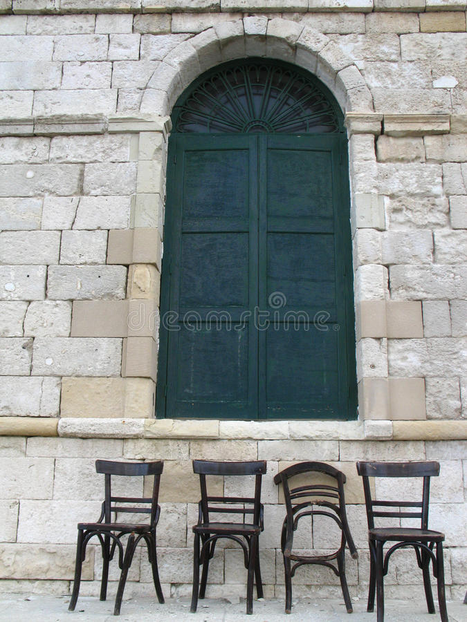 Venetian window style and chairs royalty free stock photo