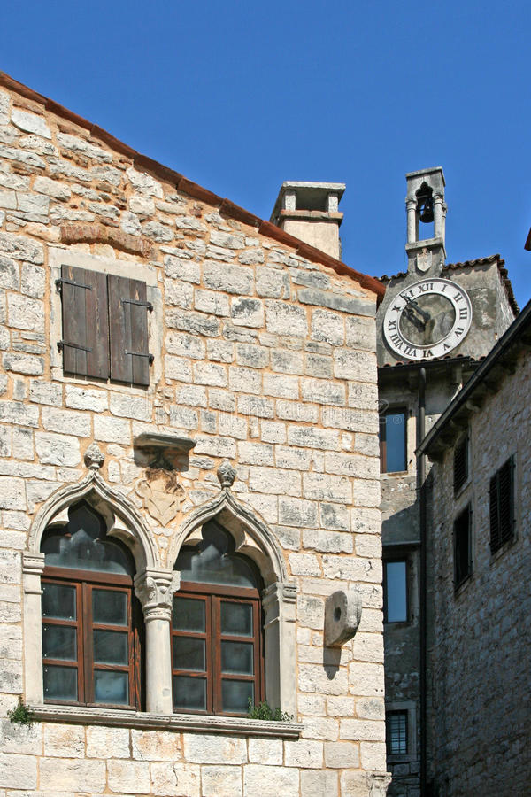 Venetian Windows On The Old Palace With The Clock Royalty Free Stock Image