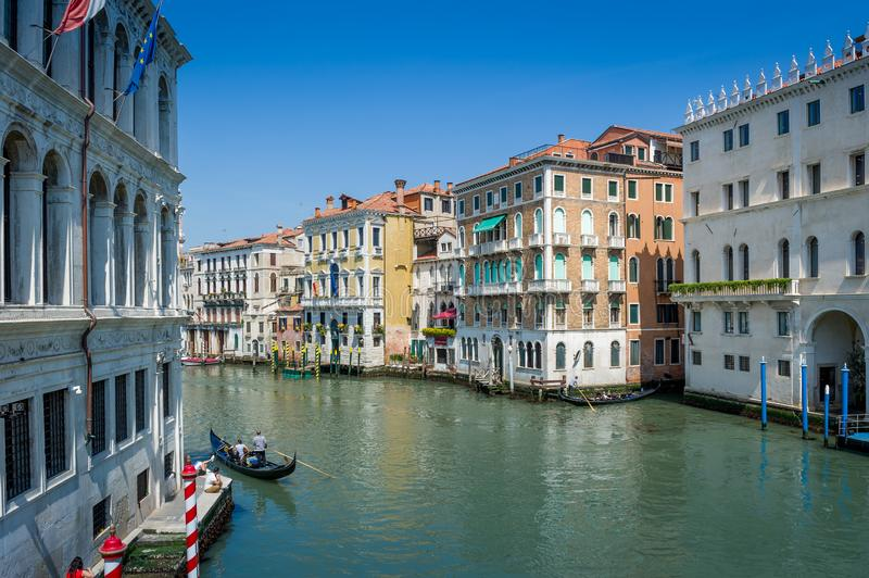 Veneto Channel Grande view with houses on the water and touristic gondolas stock photo