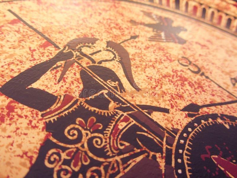 VENEZA, ITÁLIA - 2 DE JULHO DE 2017: Detalhe de uma pintura grega histórica velha sobre um prato Heróis míticos e deuses que luta fotos de stock royalty free