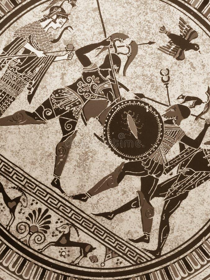 VENEZA, ITÁLIA - 2 DE JULHO DE 2017: Detalhe de uma pintura grega histórica velha sobre um prato Heróis míticos e deuses que luta fotografia de stock
