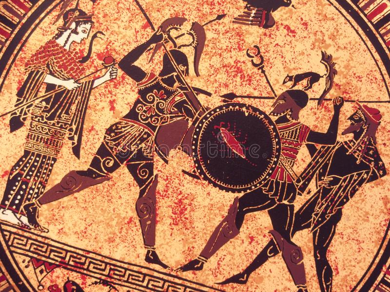 VENEZA, ITÁLIA - 2 DE JULHO DE 2017: Detalhe de uma pintura grega histórica velha sobre um prato Heróis míticos e deuses que luta imagem de stock royalty free