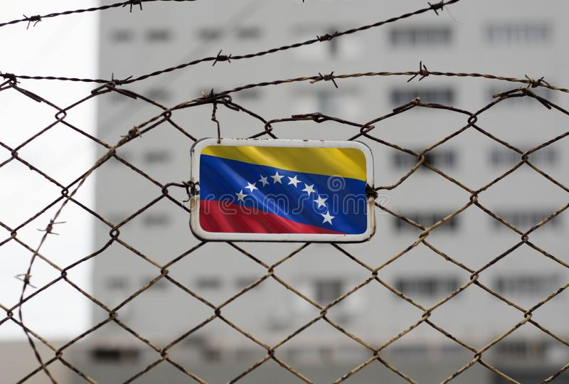 Venezuela flag on the fence of a jail royalty free stock photos