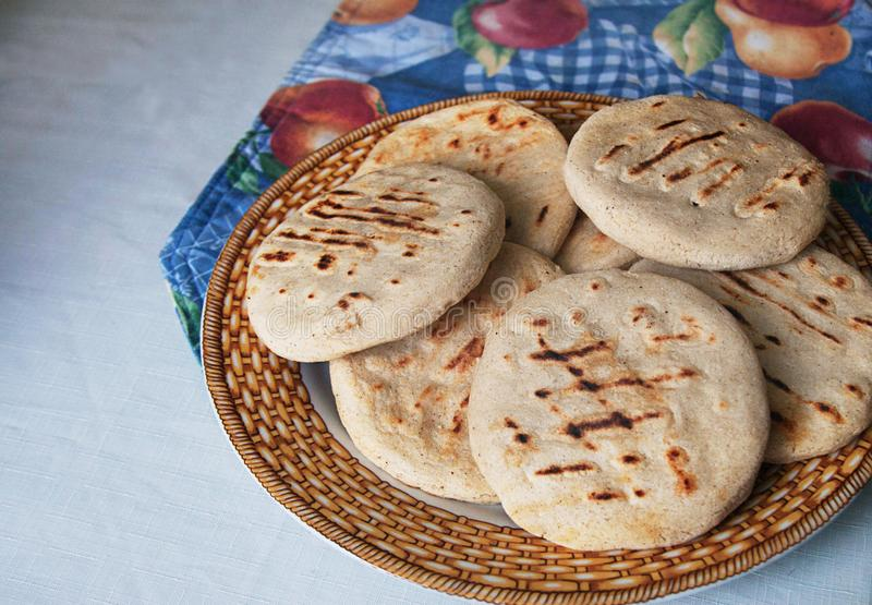 Venezuelan Arepas served on a table royalty free stock photo