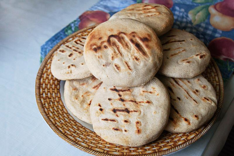 Venezuelan Arepas served on a table royalty free stock photos