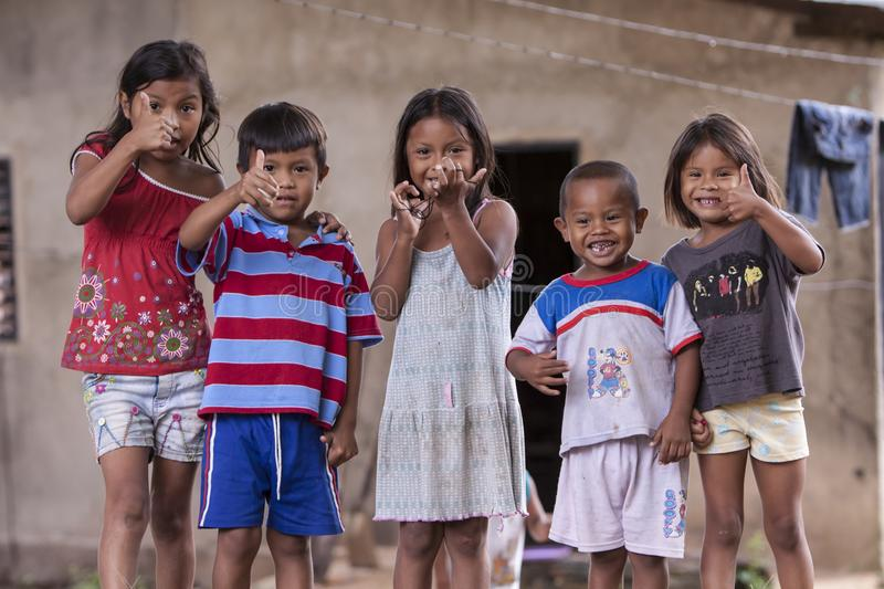 Venezuelan children showing thumbs up stock images