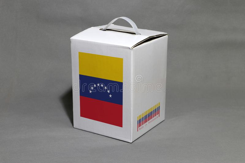 Venezuelan flag on white box with barcode and the color of nation flag. The concept of export trading from Venezuela. Paper packaging for put products royalty free stock image
