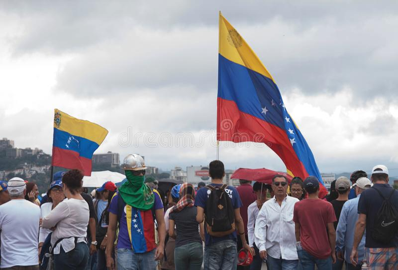 Venezuelan people protesting against Maduro. Venezuelan people protesting against Nicolas Maduro in Caracas Venezuela royalty free stock image