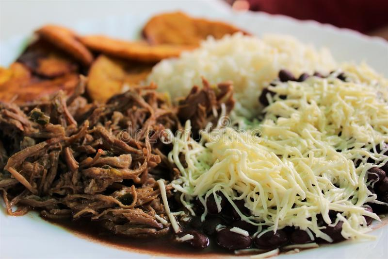 Venezuelan typical dish called Pabellon, made up of shredded meat, black beans, rice, fried plantain slices, and salty cheese. A typical Venezuelan dish called royalty free stock photos