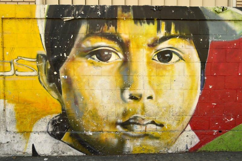 Venezuelan urban art, Maracay. Paint on a street wall in Maracay city, Venezuela. South america. Face of children looking you royalty free stock photos